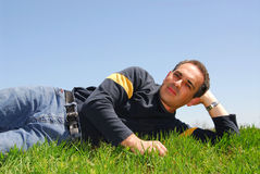 Man lying on grass royalty free stock photo