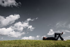 Man Lying on Grass With Hands on Head Royalty Free Stock Photos