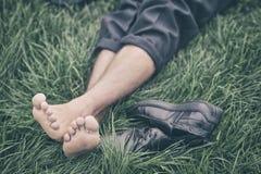 Man lying on the grass. Photo stock image