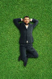 Man lying on the grass and resting Royalty Free Stock Images