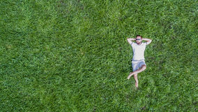 Man lying on a grass Royalty Free Stock Image