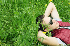 Man lying on the grass Stock Photos