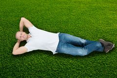 Man Lying On Grass Stock Photography