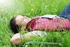 Man lying in the grass Royalty Free Stock Photos
