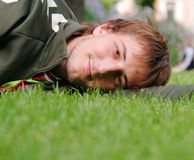 Man lying on green grass Stock Photography