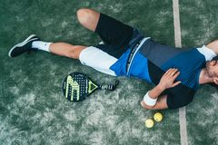 Man Lying Beside on Green Tennis Balls royalty free stock images