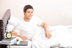 Man lying in his bed at home Royalty Free Stock Image