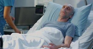 Man lying in hospital bed. Medium close up shot of man lying in hospital bed stock footage