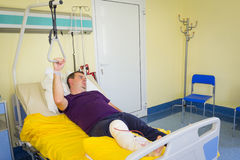 Man lying in hospital after surgery. Man lying in hospital after arthroscopic surgery Royalty Free Stock Images