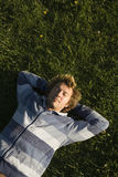 Man lying on a lawn. At the evening Royalty Free Stock Images