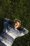 Man lying on a lawn. At the evening Stock Image