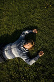 Man lying on a lawn. At the evening Royalty Free Stock Photography