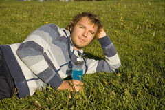 Man lying on a lawn Royalty Free Stock Photography