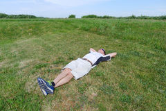 Man Lying on the Lawn Relaxing Royalty Free Stock Photo