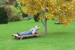 A man, lying on a lounger Royalty Free Stock Photography