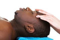 Man lying on a massage table Royalty Free Stock Image
