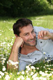 Man lying in a meadow Stock Photo