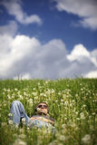 Man lying in meadow resting Stock Photos