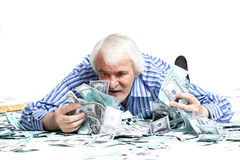 Man lying in the money Stock Photo
