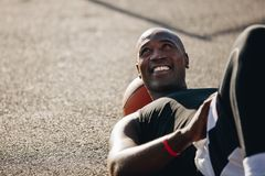 Free Man Lying On Ground With Basketball Under His Head Royalty Free Stock Images - 116451349