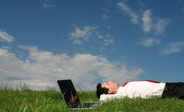 Free Man Lying On The Grass Stock Image - 2586441