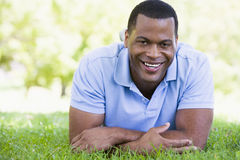 Man lying outdoors smiling Royalty Free Stock Photos