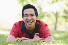 Man lying outdoors smiling Stock Photo