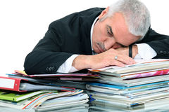 Man lying on paperwork Royalty Free Stock Images