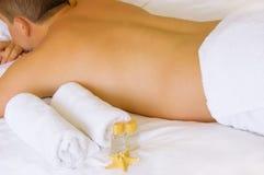 Man lying ready for massage Stock Photos