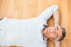 Man lying and relaxing on the floor Stock Photo