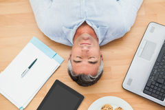 Man lying and sleeping on the floor Stock Images