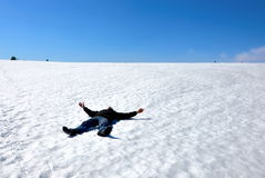 Man lying on the snow Royalty Free Stock Photo