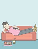 Man lying on sofa. An asian man lying on a sofa holding a remote with three donuts on the plate and soda on the floor. Vector line design illustration. Vertical Royalty Free Stock Photo