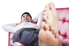 Man lying on sofa while dreaming Stock Images