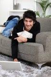 Man lying on a sofa Royalty Free Stock Photography