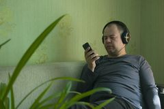 A man listens to music on the phone stock photography