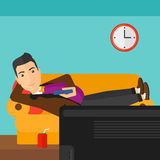 Man lying on sofa. A man lying on a sofa and watching tv with a remote control in his hand and soda on the floor vector flat design illustration. Square layout vector illustration