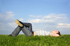 Man lying on summer lawn with closed eyes Stock Photos