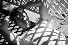 Man lying on the sun looking in to camera Stock Images