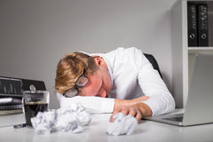 Man lying on the table at the office Stock Images