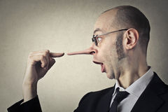 Man lying. Man telling lies and nose growing Royalty Free Stock Image