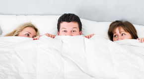 Man lying with two girls Royalty Free Stock Photo