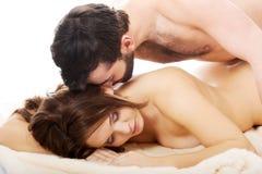 Man lying on women in bedroom. Stock Photos