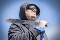 Man with machete on shoulder Royalty Free Stock Photo