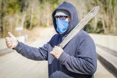 Man with machete try to stop car. In summer day stock image