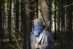 Man with a machete in the woods Stock Photo