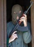 Man with a machine gun Royalty Free Stock Photos