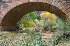 Man made Arch. Zion National Park's Pine Creek bridge provides an archway for colorful fall foliage Stock Images