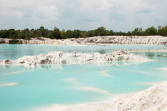 Man-made artificial clear blue lake Kaolin, mining ground holes covered by rain water. Man-made artificial lake Kaolin, turned from a mining ground holes. Land Royalty Free Stock Photos