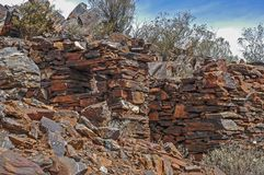 Man made Banded Iron Rock hut, built by gold prospector. royalty free stock images